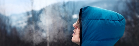 man-breathing-in-cold-air